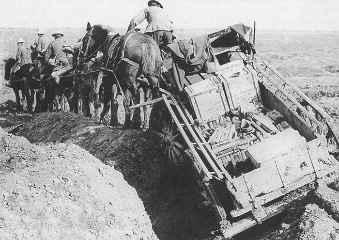 Ammunition wagon team struggling through a lunar landscape of the First World War